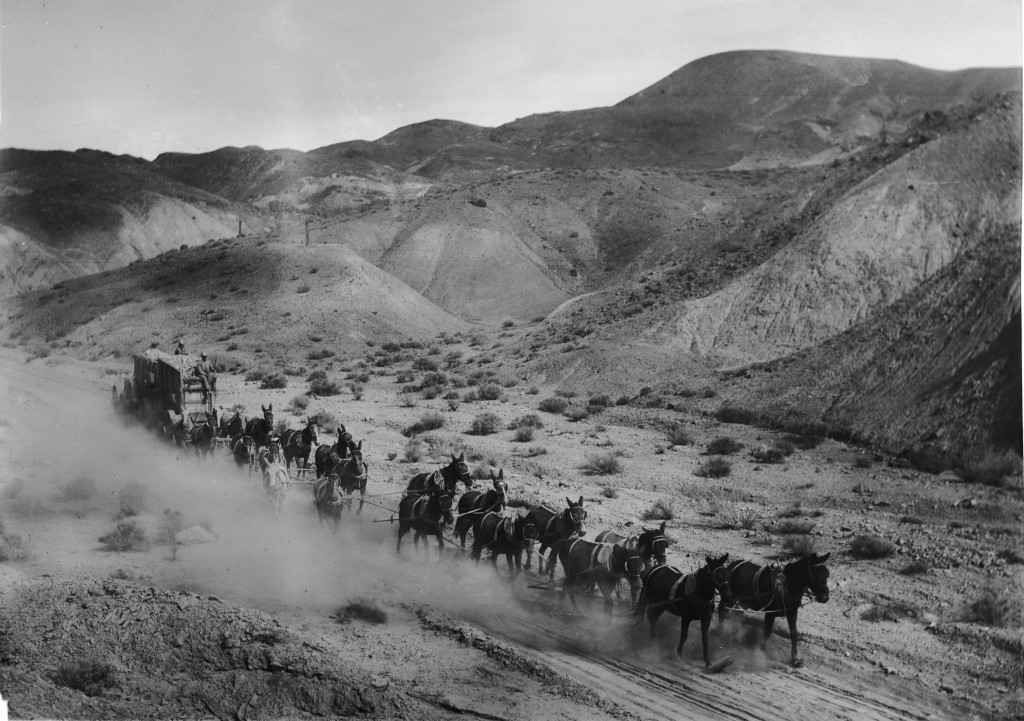 """Twenty-mule team hauling borax out of Death Valley to the railroad, ca.1900 (CHS-1618)"" by Not given - https://goo.gl/qTU4bO"