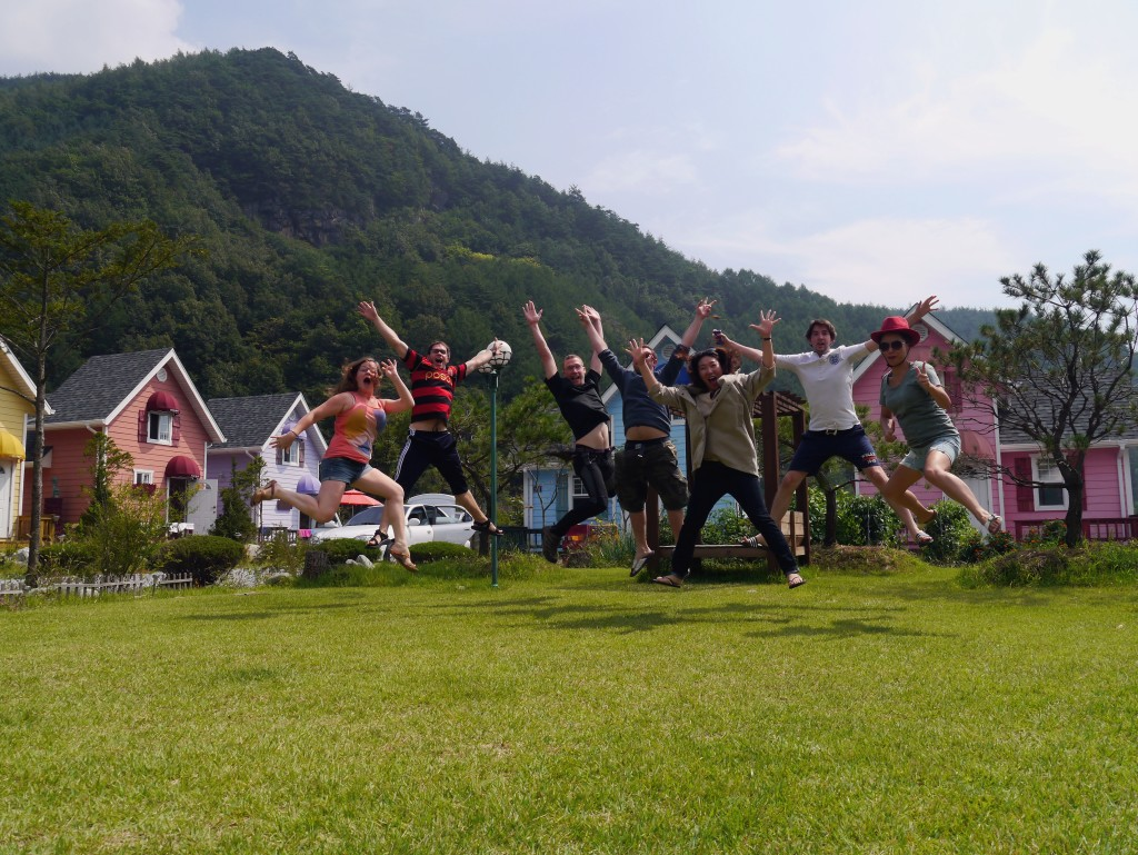 Our group of friends pulling off a jump shot in front of Morebul Pension in Auraji