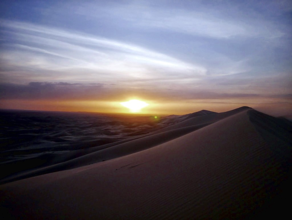 Climbing up the Khongoryn Els in the Gobi to catch a magnificent sunset